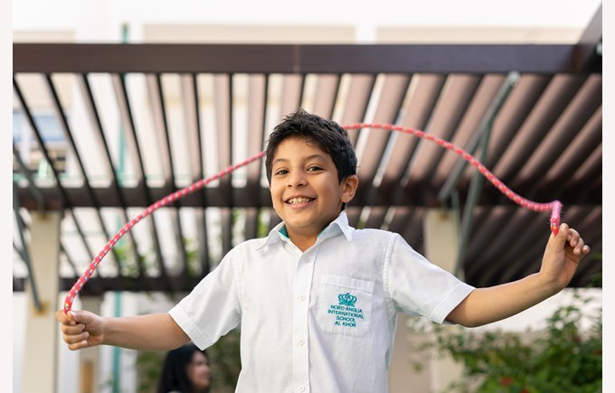 Boy with skipping rope