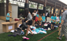 Students from the British international School Shanghai, Puxi sorting clothes donations for River of Hearts.
