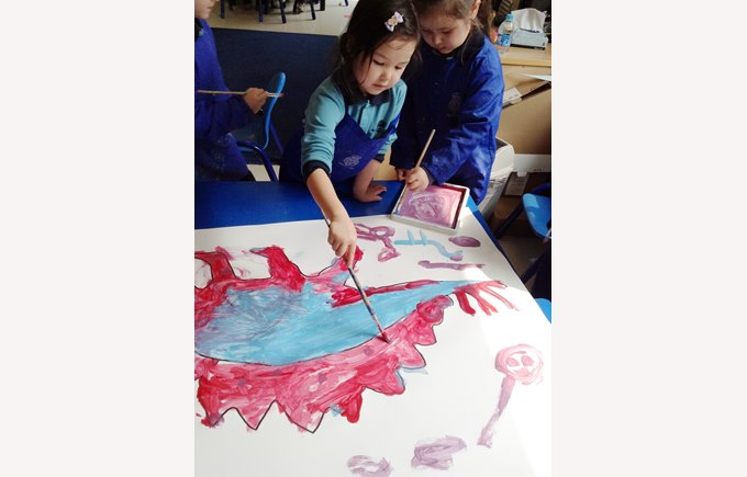 Reception drawing dinosaurs