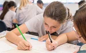 Secondary Girl writing
