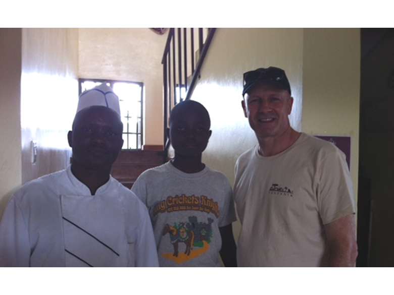 Mr Foyle visiting an orphanage that Nord Anglia Education is helping