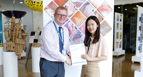 Emily Ding received IB scholarship from Principal Nick West