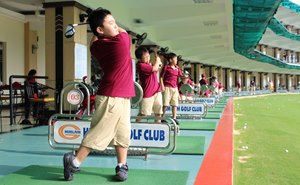 Golfing students in golf range