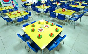Example of a table and chairs in the canteen ready for lunch