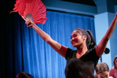 Juilliard world stage girl performing with fan