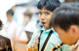 St. Andrews International School student playing a saxophone.