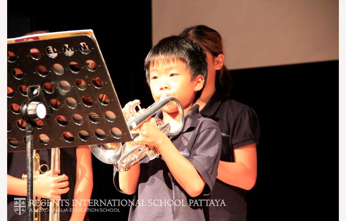 Primary boy playing trumpet