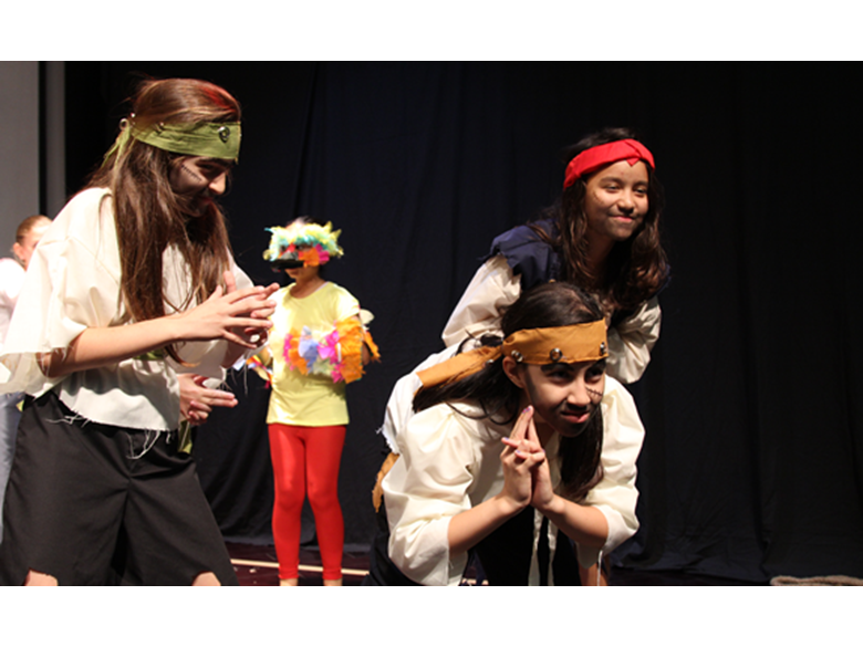 Primary students performing in Treasure Island
