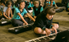 Students playing keyboard in music room