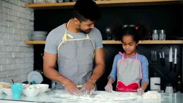 dad and kid cooking together
