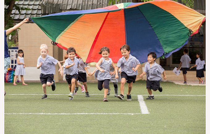 young students running colour cloth