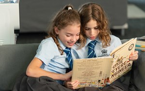 Two girls reading