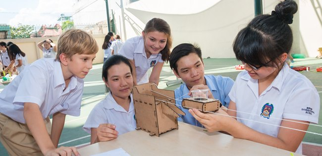 Group of mixed secondary students learning