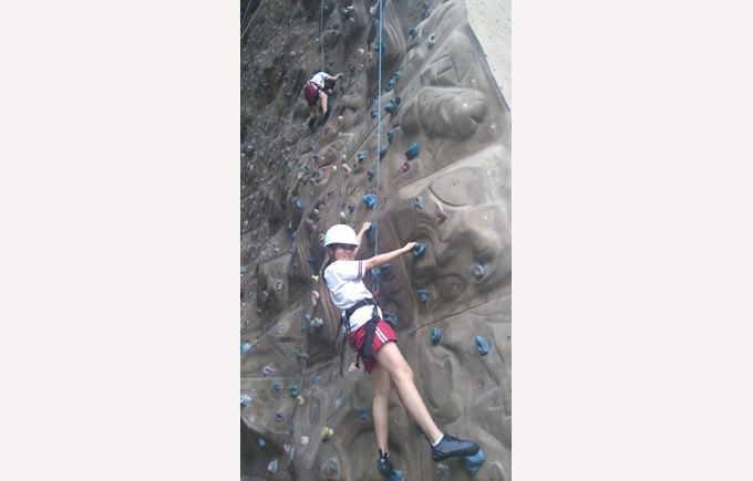 Student rock climbing as part of extra curricular clubs
