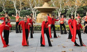 Students participate in Dance Unites in a local park in Shanghai