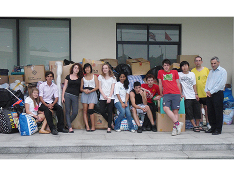 Students from the British international School Shanghai, Puxi sorting clothes donations in 2008 for River of Hearts.