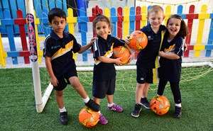 Rayyan students with footballs