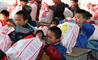 Students at the British International School Shanghai, Puxi donating Giving Tree bags to migrant children