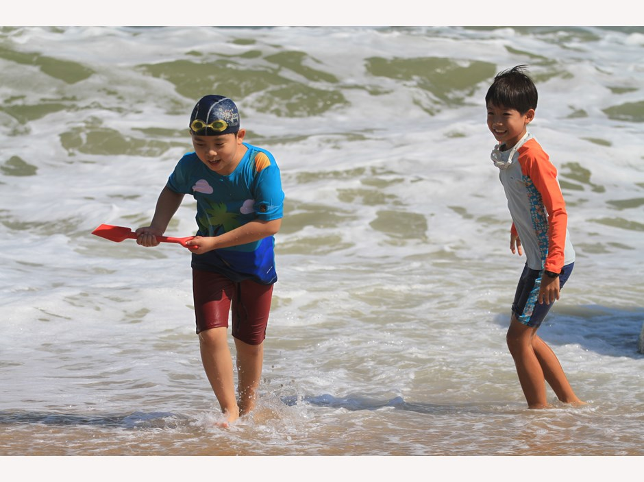 Two boys playing at the beach