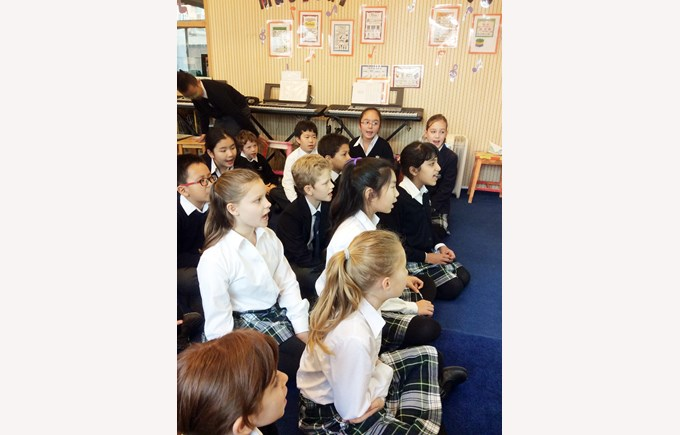 Working hard to learn our class assembly songs