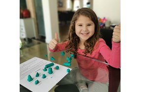 Leire making 3D shapes with playdough 540x329