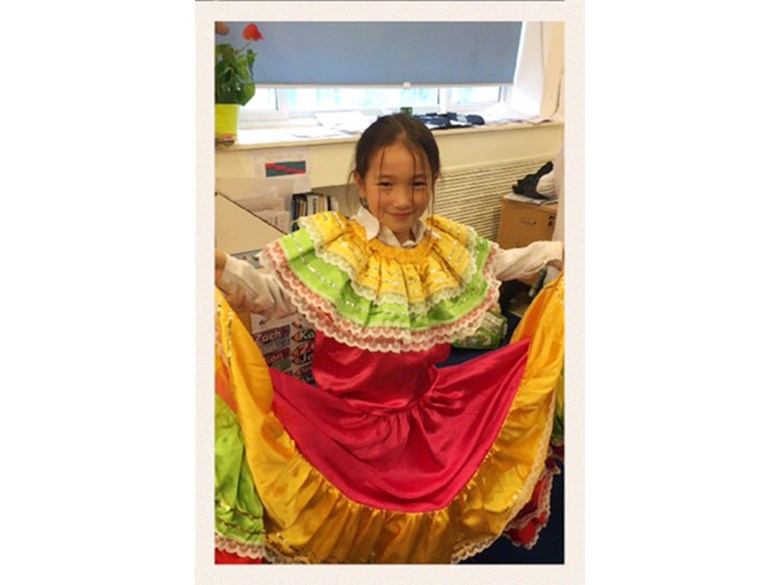 Trying on traditional Colombian costumes