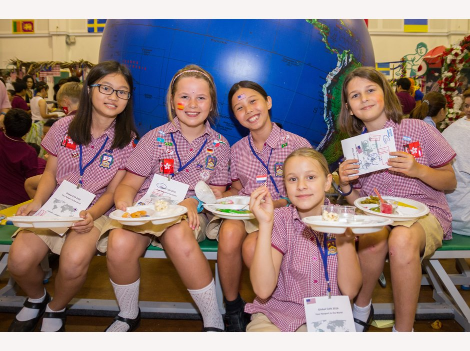 Five girls enjoying food at AP1 International Week