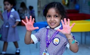 Girl showing messy hands