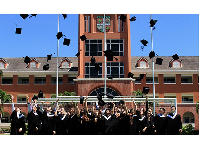 Regents' students throw their mortar boards in celebration