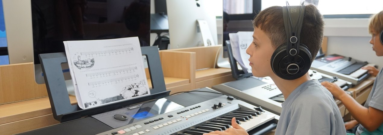 Student from International School Hong Kong playing music in the Juilliard Keyboard Lab.