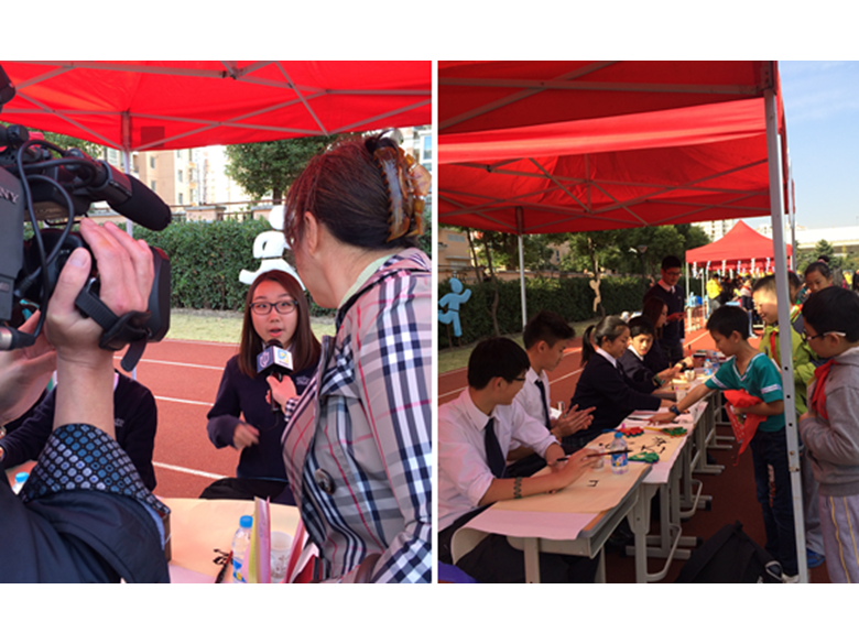 Students from the British International School Shanghai, Puxi entertain crowds with Chinese calligraphy at the Huacao Town Art Festival