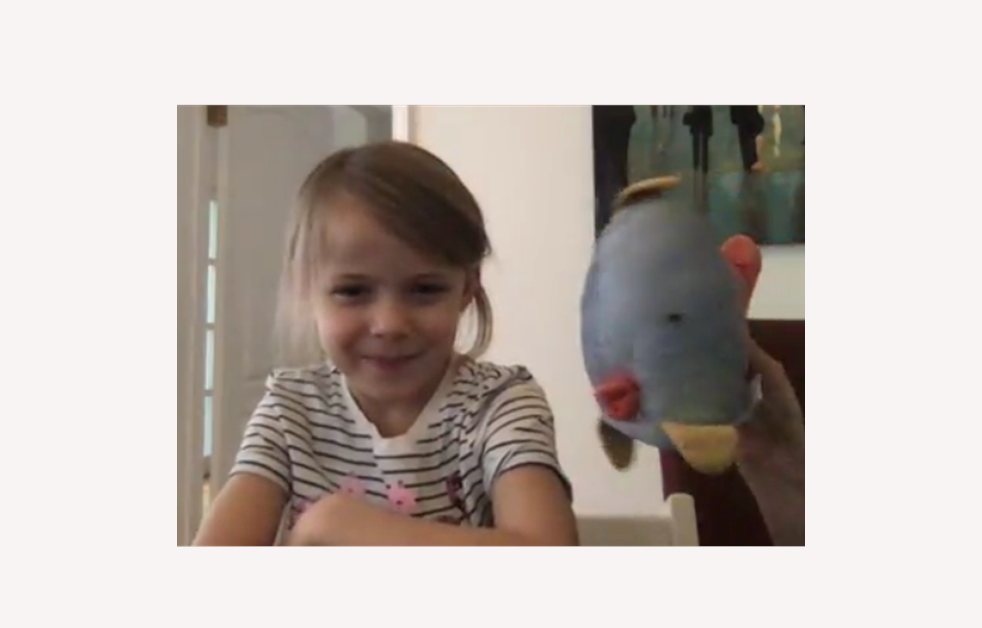 Ella telling a story with her puppet