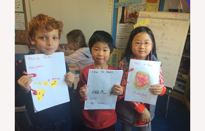 ESL students in Primary School show off their work