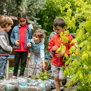 young children learning about nature on an outdoor campus