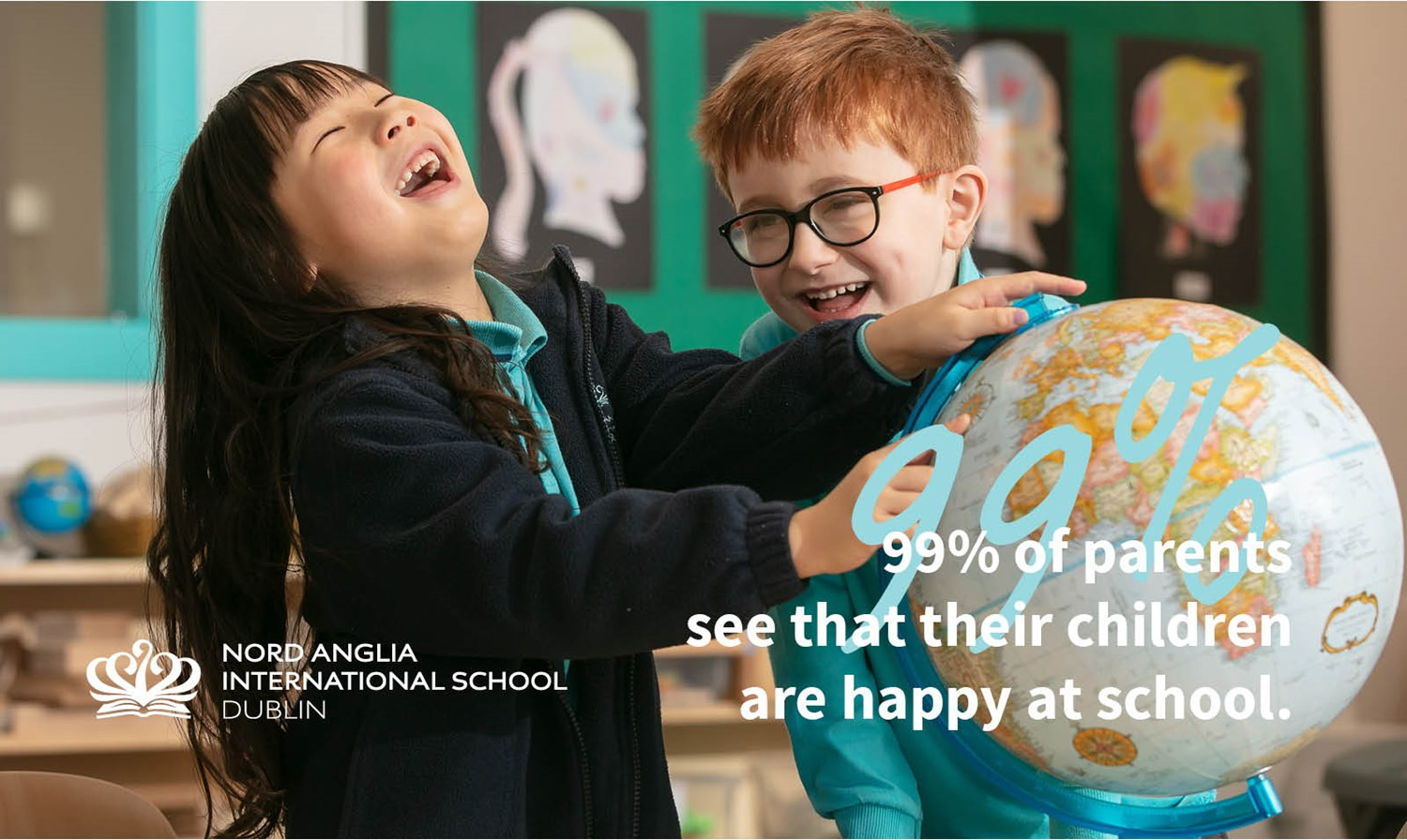 Infant students laughing with the globe