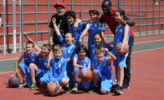 Winners of the League the ICS BAsketball Alevines Team with their Trainor