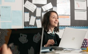 Smiling Student on laptop