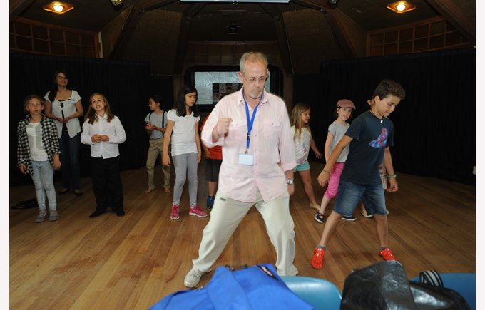 Juan Carlos Martin teaches musical theatre with the ICS Broadway activity
