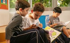 Primary students reading in class