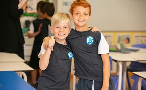 Two Primary boys in PE Uniform thumbs up
