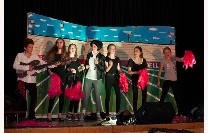 Students perform the musical Grease