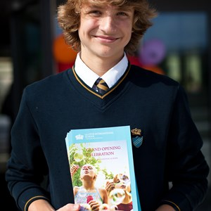 Secondary Student with Grand Opening Brochure