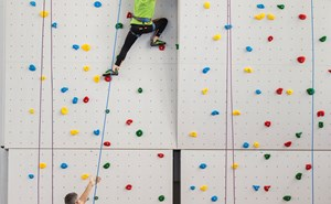 Girl on indoor climbing wall