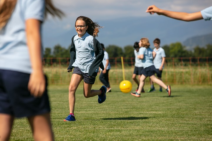 Primary students on the LCIS sports field