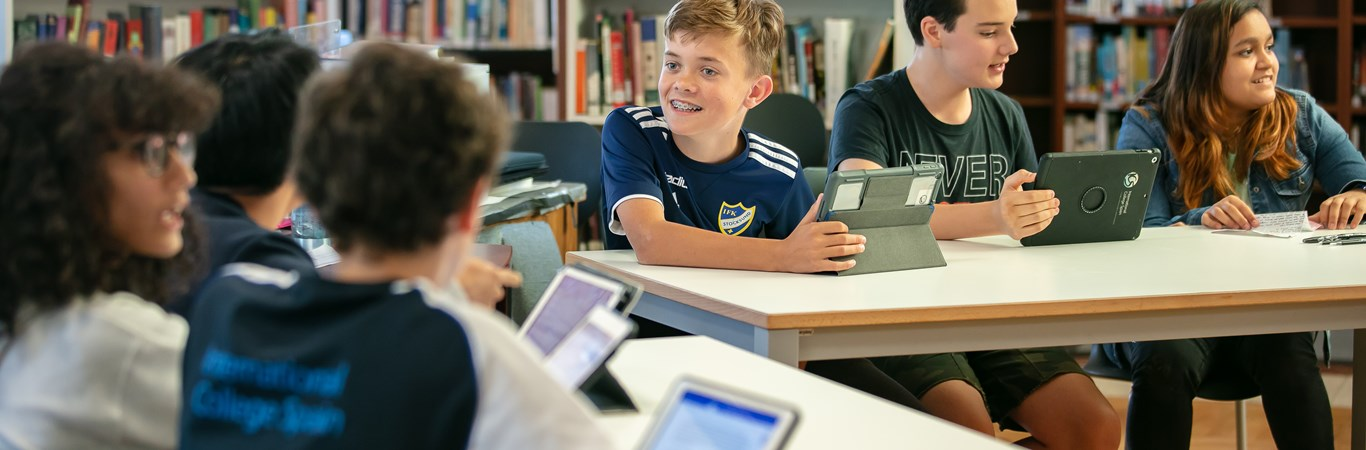 PPC Landing Hero Image ICS students in Secondary library