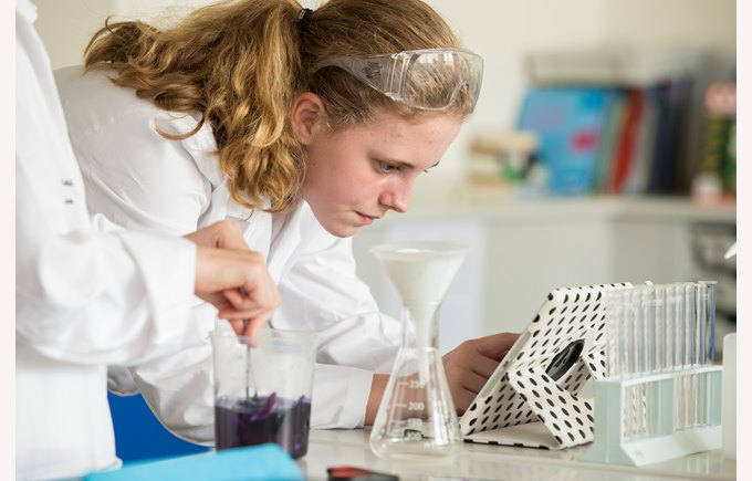 Female secondary student in laboratory