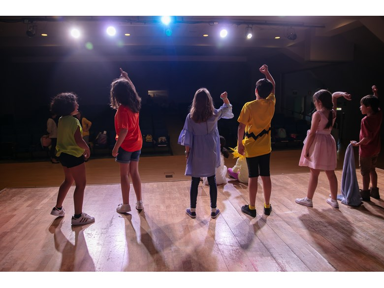 Primary children onstage play rehearsal extracurricular activities ICS