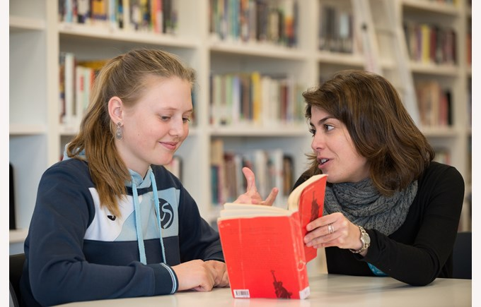 Library Laura teacher reading with student Denis 2020
