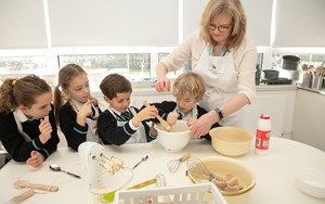 Teacher and students baking