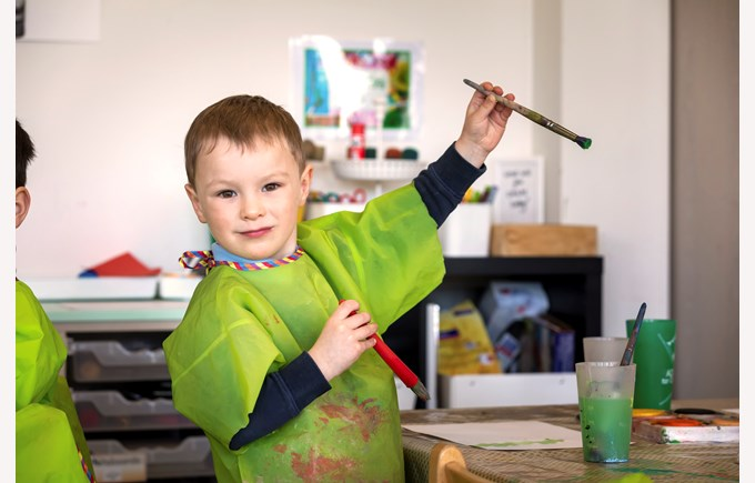 Early Years student enjoys his arts class